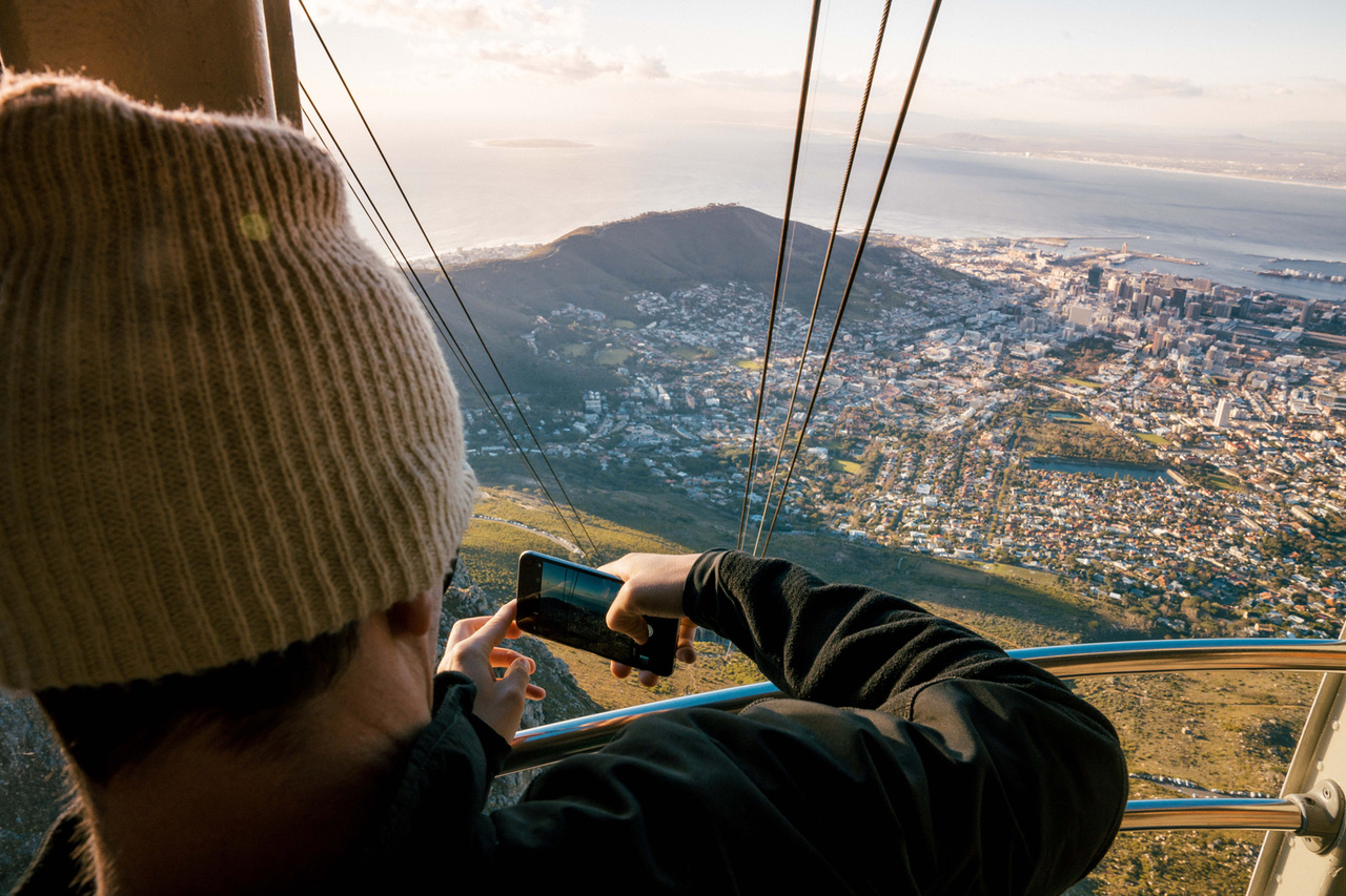 Taking a photo of the journey on the Table Mountain Cableway with saffa tours private guiding and tours
